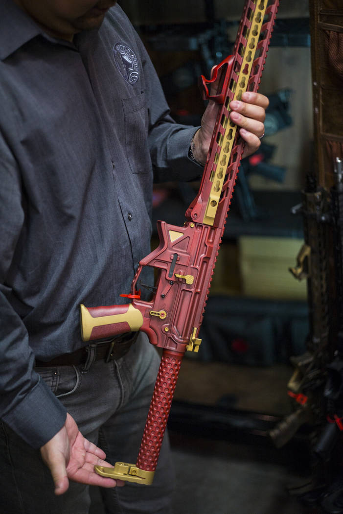 Battle Arms Development President George Huang with a customized AR-15 rifle inspired by Iron Man at the original location for his company at 180 Cassia Way in Henderson on Wednesday, Sept. 20, 20 ...