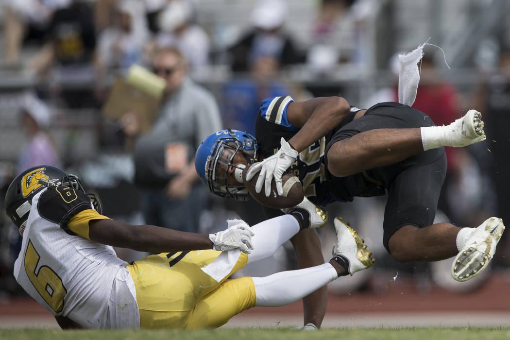 Sierra Vista's Kaika Faatiliga (36) is tackled by Clark's Isaiah Bigby (6) in their football game at Sierra Vista High School in Las Vegas, Saturday, Sept. 23, 2017. Sierra Vista won 49-14. Erik V ...