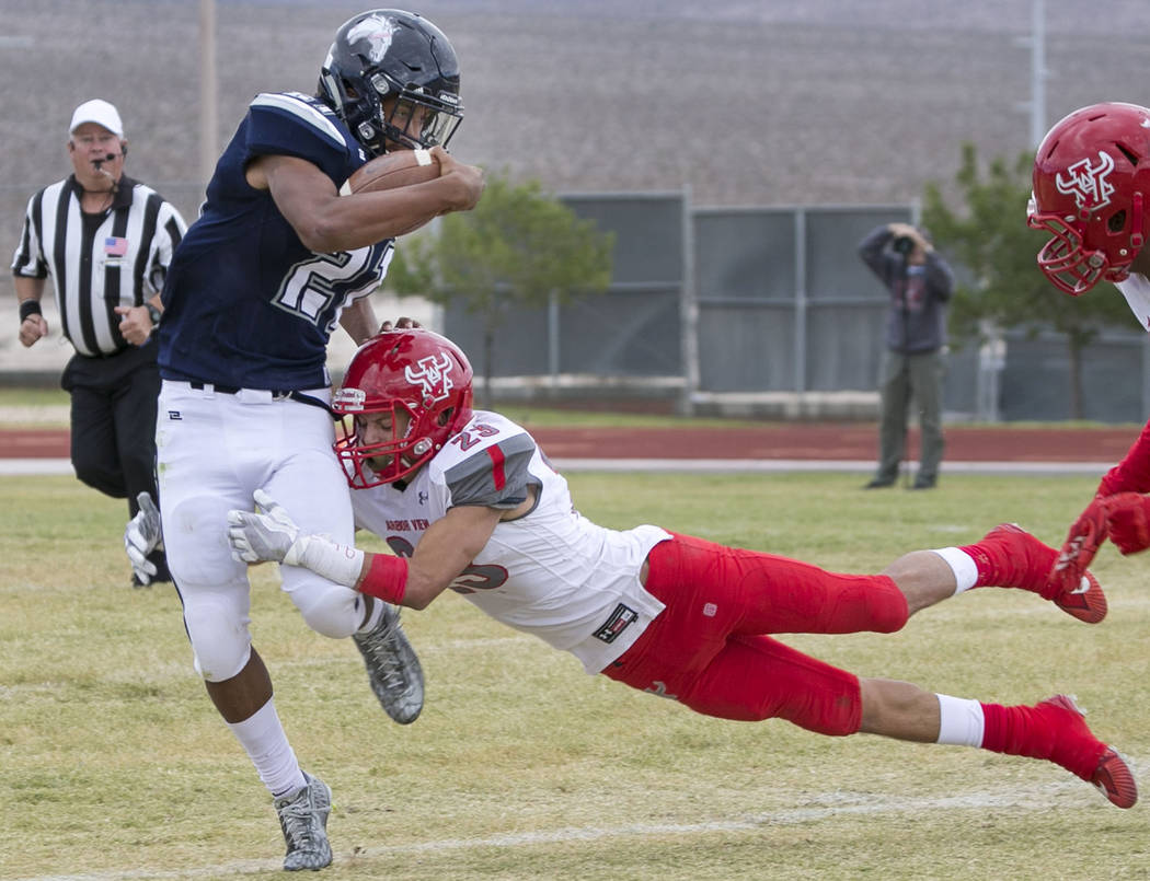 Shadow Ridge's Kaejin Smith-Bejgrowicz (21) is tackled by Arbor View's Deago Stubbs (23) during a football game at Shadow Ridge High School on Saturday, Sept. 23, 2017, in Las Vegas. Richard Brian ...