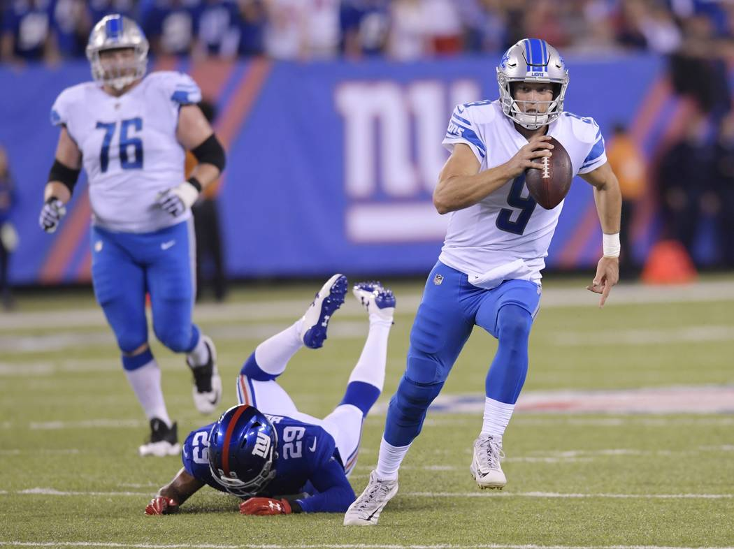 Detroit Lions quarterback Matt Stafford (9) rushes away form New York Giants' Nat Berhe (29) during the first half of an NFL football game, Monday, Sept. 18, 2017, in East Rutherford, N.J. (AP Pho ...