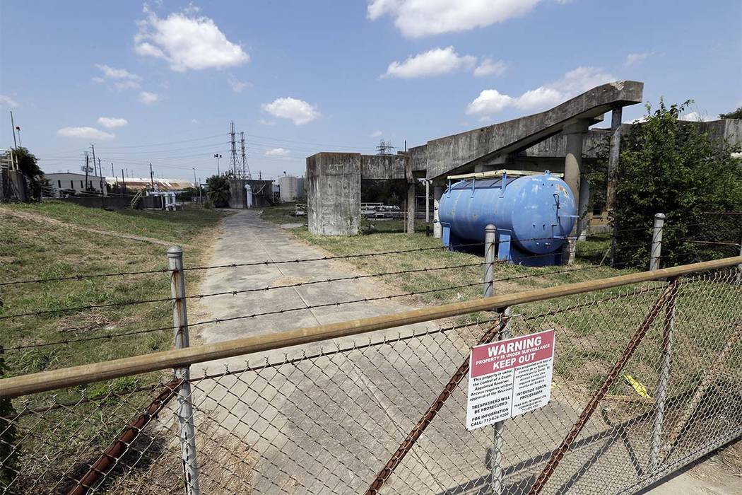 A gate at the U.S. Oil Recovery Superfund site is shown Thursday, Sept. 14, 2017, in Pasadena, Texas, where three tanks once used to store toxic waste were flooded during Hurricane Harvey. The Env ...