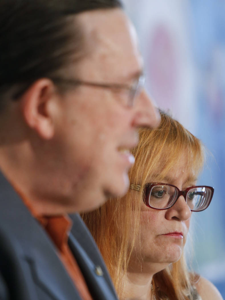 Lynne Schultz, right, mother of Scout Schultz, looks on as her husband, Bill Schultz, speaks at a news conference in Atlanta, Ga., Monday, Sept. 18, 2017. Scout was a 21-year-old Georgia Tech stud ...