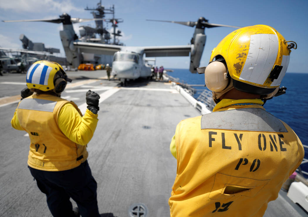 Crewmen direct pilots aboard a MV-22B Osprey  on the deck of the USS Kearsarge as the evacuation of U.S. military personnel from the U.S. Virgin Islands continues in advance of Hurricane Maria, in ...