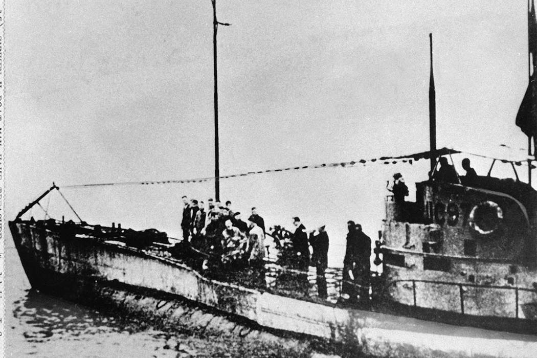 FILE - In this undated photo people stand on the deck of a World War I German submarine type UC-97 in an unknown location. Belgian regional authorities on Tuesday, Sept. 19, 2017 say that an intac ...