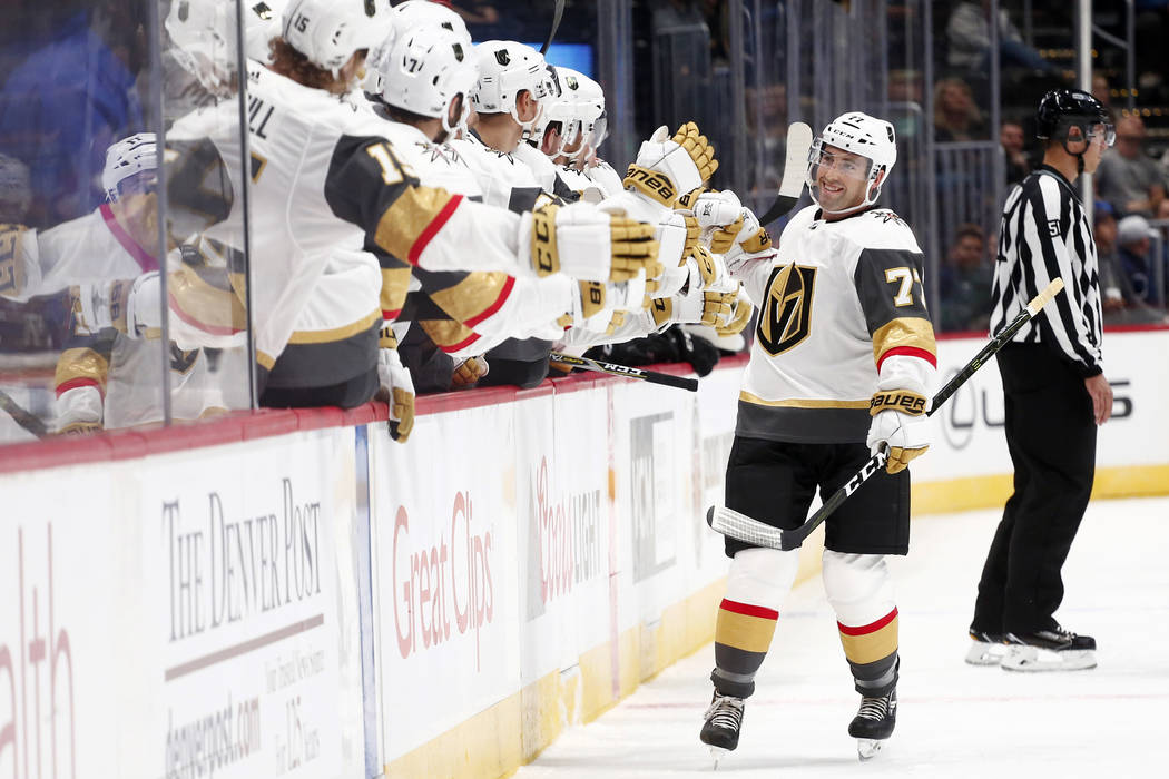 Las Vegas Golden Knights defenseman Brad Hunt celebrates a goal with teammates on the bench against the Colorado Avalanche during the first period of a preseason hockey game, Tuesday, Sept. 19, 20 ...