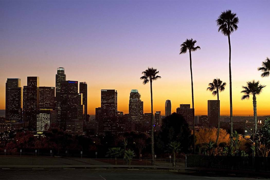 FILE - In this Jan. 21, 2011, file photo, the sun sets beyond the Los Angeles skyline, as seen from Dodger Stadium in Los Angeles. The U.S. Geological Survey said a magnitude-3.6 quake hit at abou ...