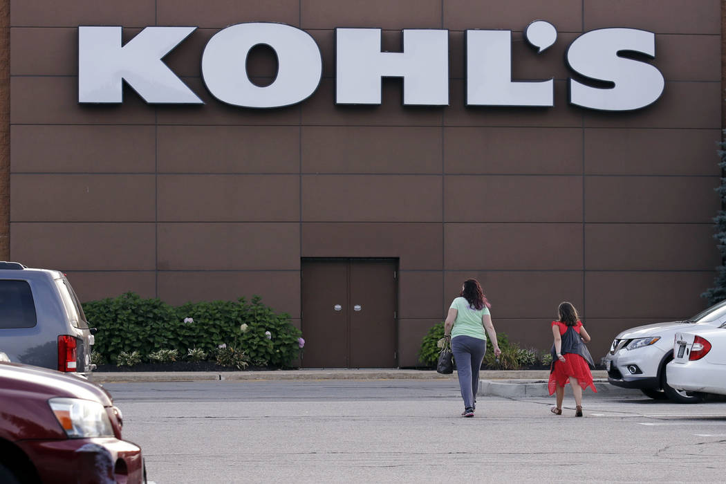 Shoppers walk to a Kohl's retail store in Salem, N.H. on Tuesday, Aug. 22, 2017. Kohl's, which is opening some in-store Amazon shops, will start accepting returns for the online retailer at some o ...