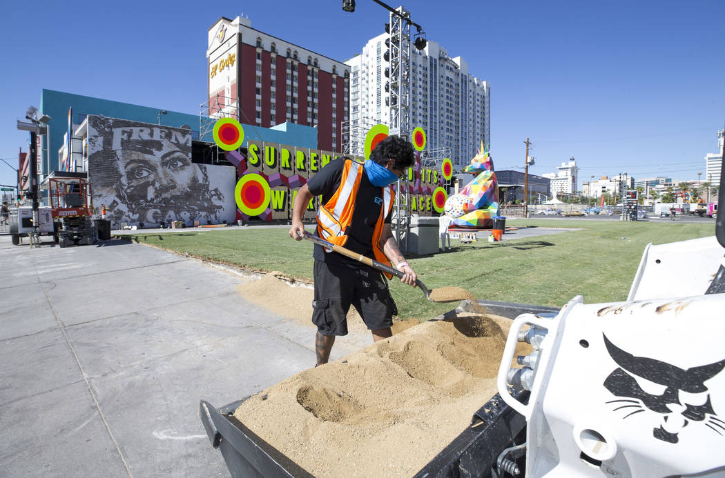 Stagehand Luis Herrera edges out sod in preparation for the Life is Beautiful festival in downtown Las Vegas on Thursday, Sept. 21, 2017. Richard Brian Las Vegas Review-Journal @vegasphotograph