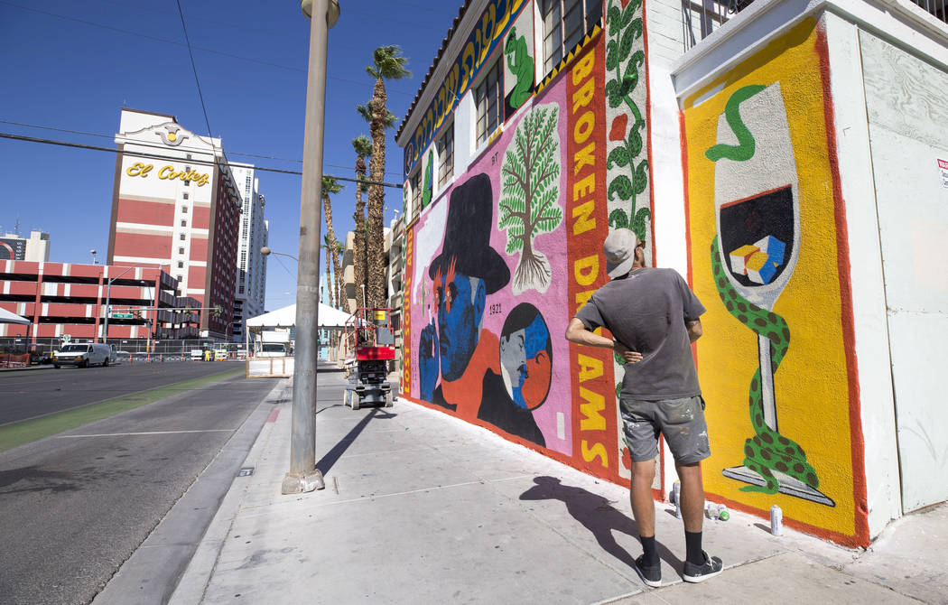 A painter who did not want to be identified surveys his work as preparations continue on the festival grounds of Life is Beautiful in downtown Las Vegas Thursday, Sept. 21, 2017. Richard Brian Las ...