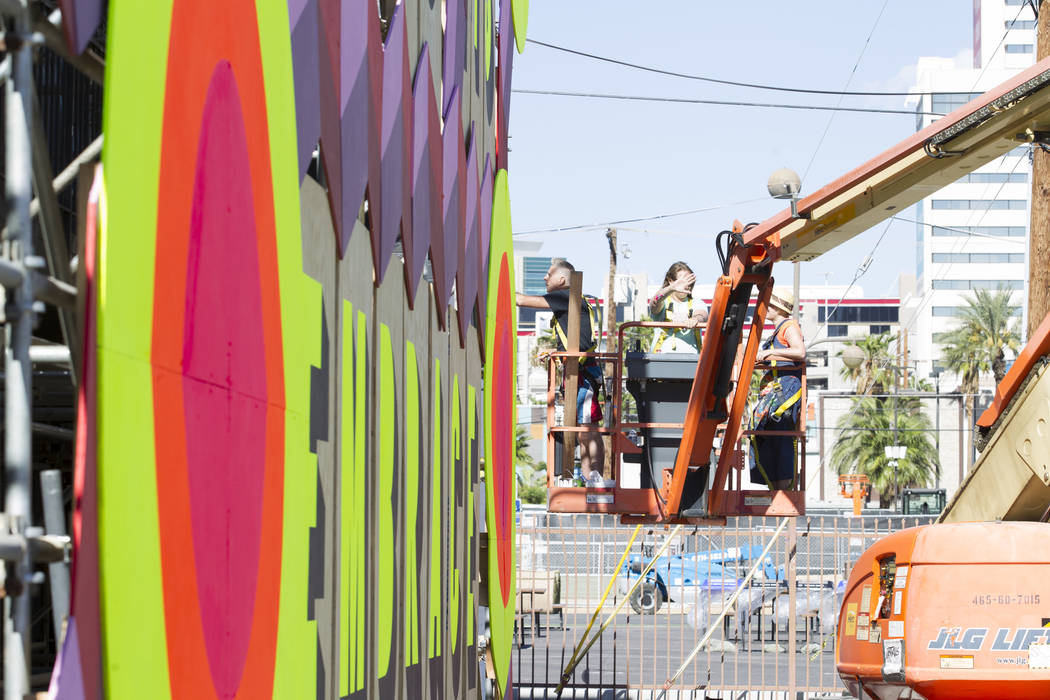 A group of painters work on a mural as preparations continue on the festival grounds of Life is Beautiful in downtown Las Vegas Thursday, Sept. 21, 2017. Richard Brian Las Vegas Review-Journal @ve ...