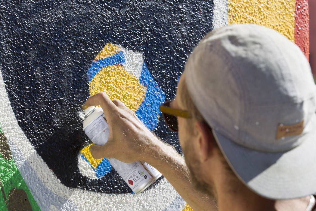 A painter who did not want to be identified works on a mural as preparations continue on the festival grounds of Life is Beautiful in downtown Las Vegas Thursday, Sept. 21, 2017. Richard Brian Las ...