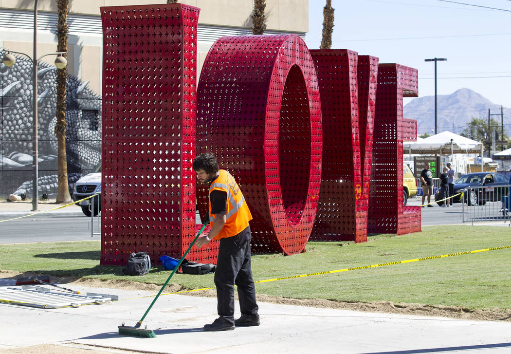 A worker sweeps the sidewalk as preparations continue on the festival grounds of Life is Beautiful in downtown Las Vegas Thursday, Sept. 21, 2017. Richard Brian Las Vegas Review-Journal @vegasphot ...