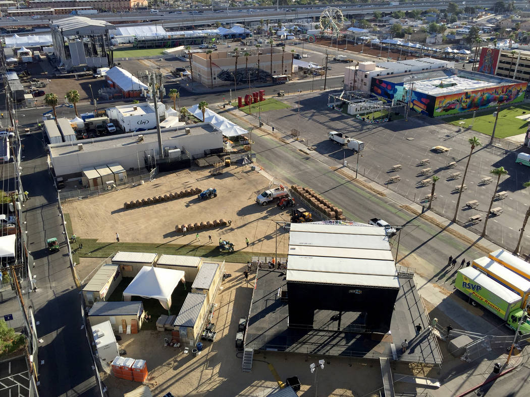 Sod is rolled in front of the Huntridge Stage in preparation for the Life is Beautiful music and arts festival in downtown Las Vegas Thursday, Sept. 21, 2017. The three-day event runs Friday throu ...