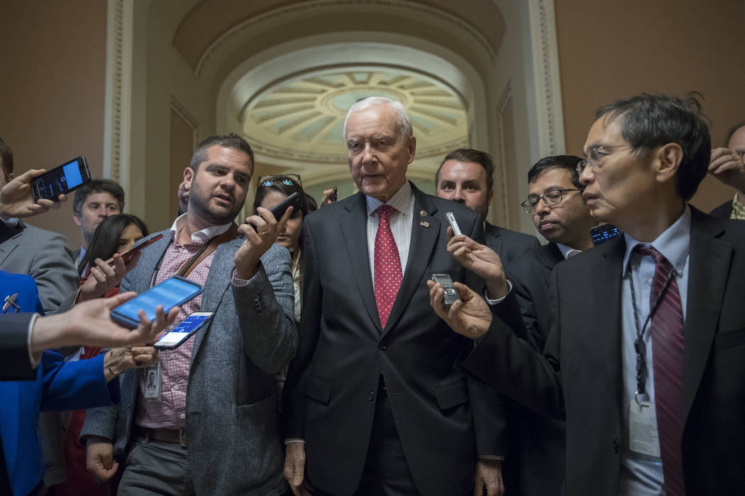Senate Finance Committee Chairman Orrin Hatch, R-Utah, is surrounded by reporters as he walks to a closed-door meeting at the Capitol in Washington, Tuesday, Sept. 12, 2017. (AP Photo/J. Scott App ...