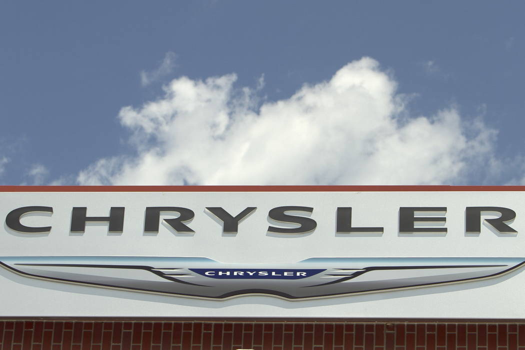 The Chrysler logo is displayed at a car dealership in Omaha, Neb. on July 22, 2011. (Nati Harnik/AP)
