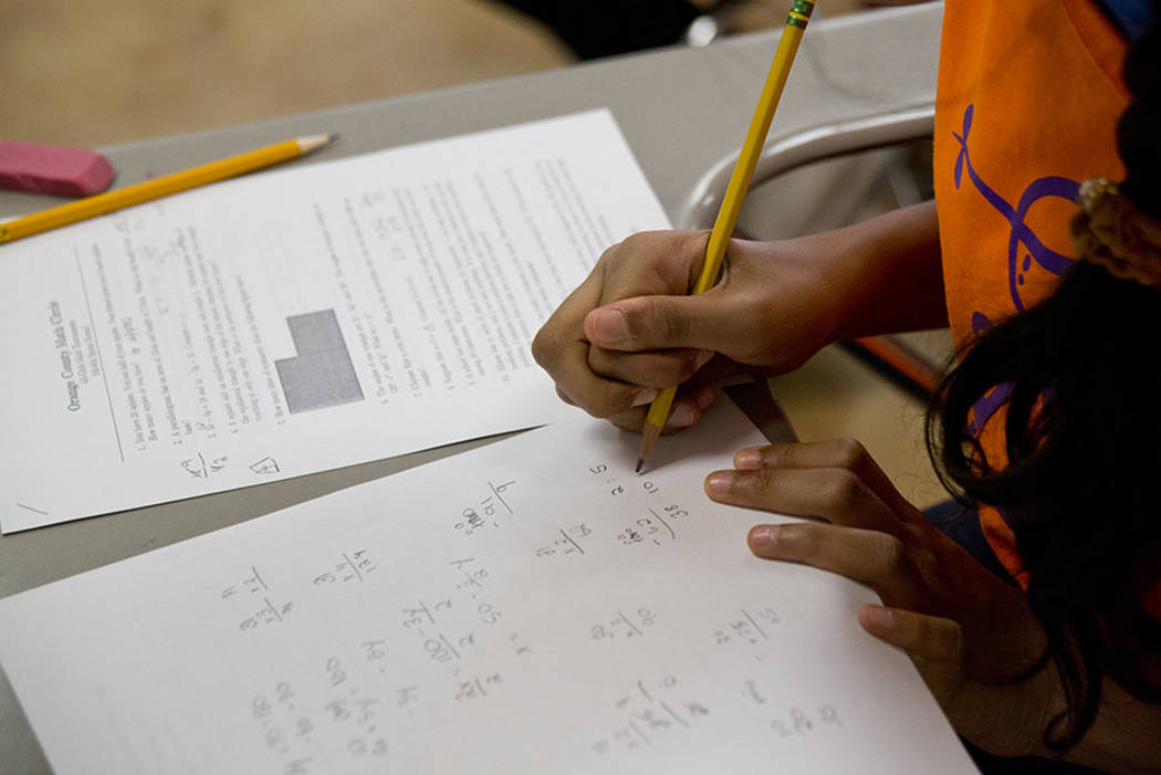 A student takes a written exam during the Orange County Math Circle, an all-girls math tournament, at the Coral Academy of Science Las Vegas in 2016. (Las Vegas Review-Journal)
