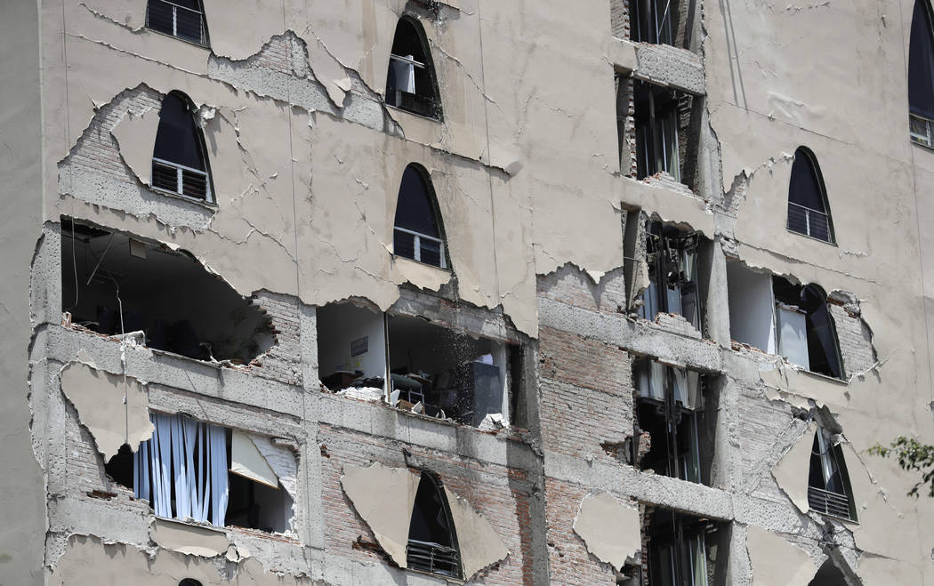 Remains of a damaged building stands after an earthquake in Mexico City, Tuesday, Sept. 19, 2017. A powerful earthquake has jolted Mexico, causing buildings to sway sickeningly in the capital on t ...