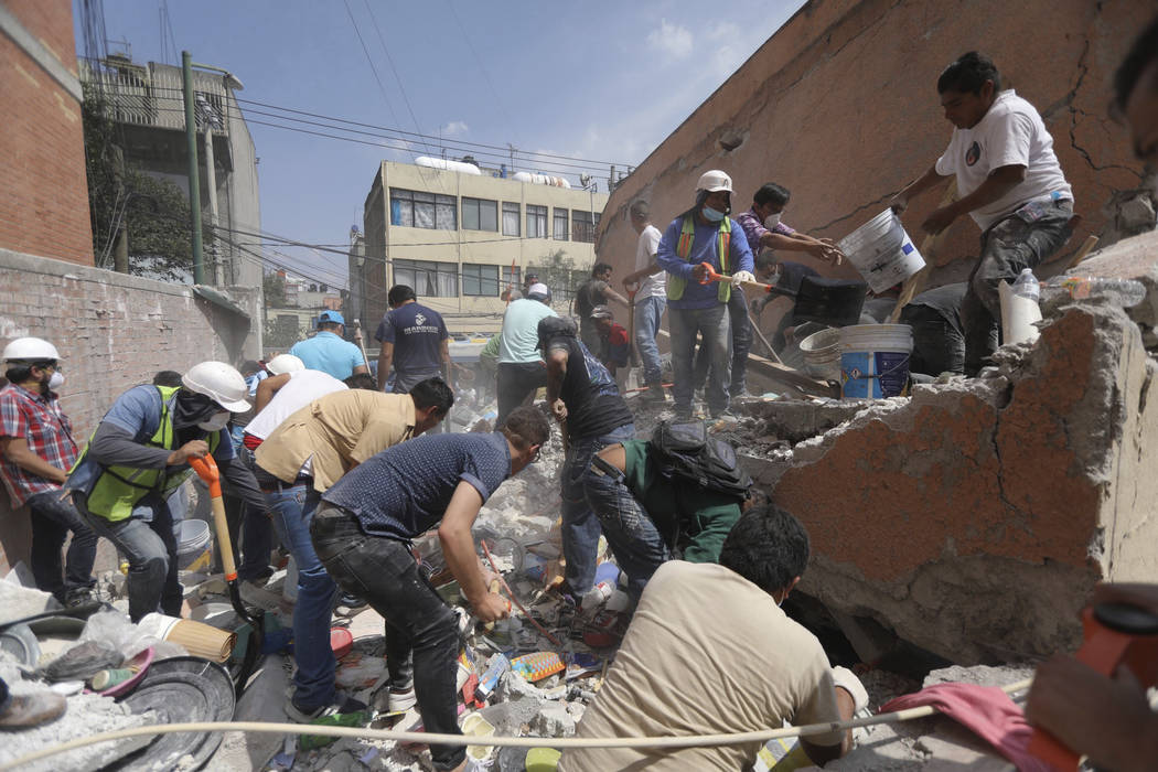 Rescue workers and volunteers search for survivors at the Ninos Heroes neighborhood in Mexico City, Tuesday Sept. 19, 2017. A magnitude 7.1 earthquake has stunned central Mexico, killing more than ...