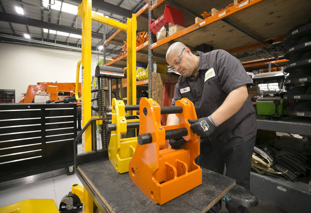 Assembly technician Robert Rosales assembles the knuckles for a multi-purpose telescopic handler on the assembly line of Xtreme Manufacturing, 8350 Eastgate Rd., in Henderson, Tuesday, Sept. 19, 2 ...