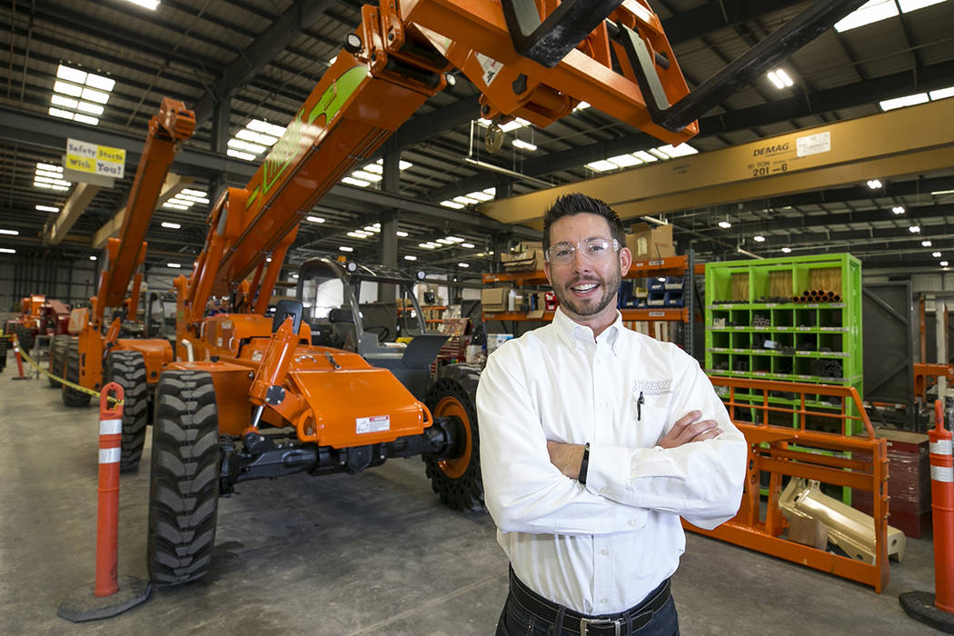 Xtreme Manufacturing President Brandon Main in front a XR1045 telescopic handler on the assembly line of Xtreme Manufacturing, 8350 Eastgate Rd., in Henderson, Tuesday, Sept. 19, 2017. Richard Bri ...