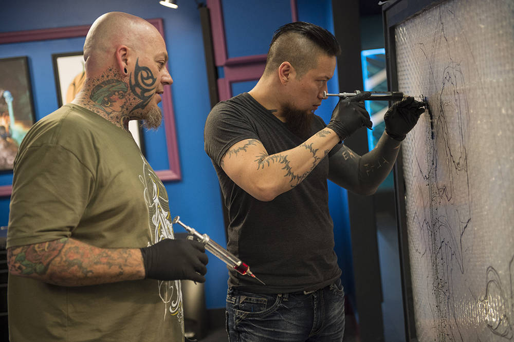 "Our Christian Buckingham and Noelin Wheeler of Basillica Tattoo are almost down to the final three in ""Ink Master,"" the Spike TV reality series. (Spike TV)"