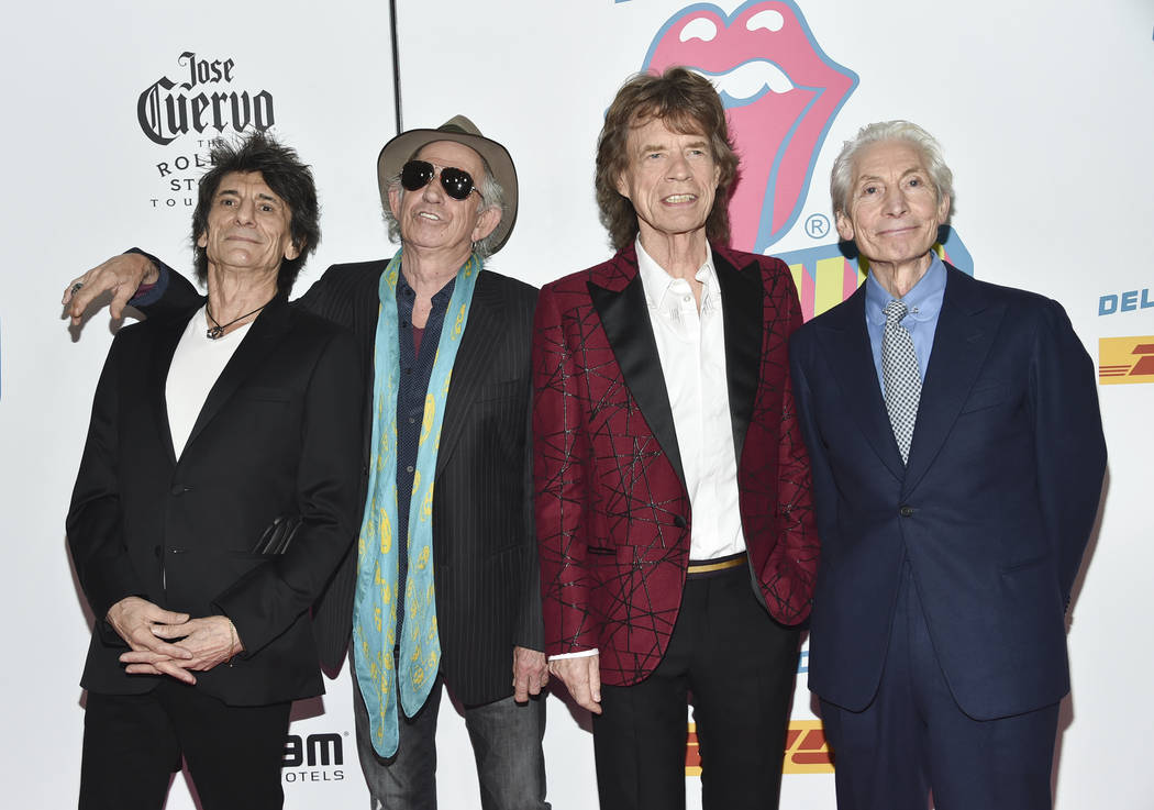 """The Rolling Stones, from left, Ronnie Wood, Keith Richards, Mick Jagger and Charlie Watts attend the opening night party for """"Exhibitionism"""" at Industria on Tuesday, Nov. 15, 201 ..."""