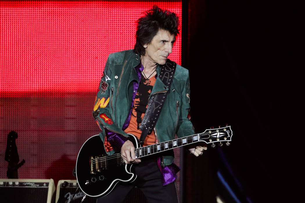 Ronnie Wood of the Rolling Stones performs during the first concert of their 'No Filter' Europe Tour 2017 in Hamburg, Saturday, Sept. 9, 2017. (AP Photo/Markus Schreiber)