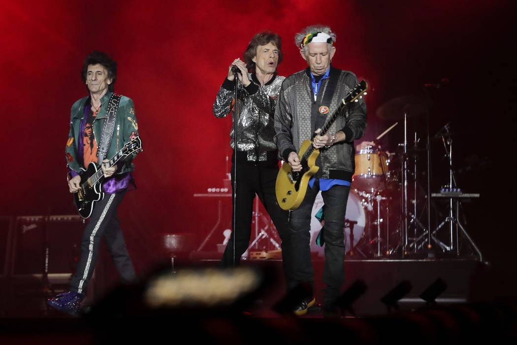 From left, Ronnie Wood, Mick Jagger and Keith Richards of the Rolling Stones perform the first concert of their 'No Filter' Europe Tour 2017 in Hamburg, Saturday, Sept. 9, 2017. (AP Photo/Markus S ...