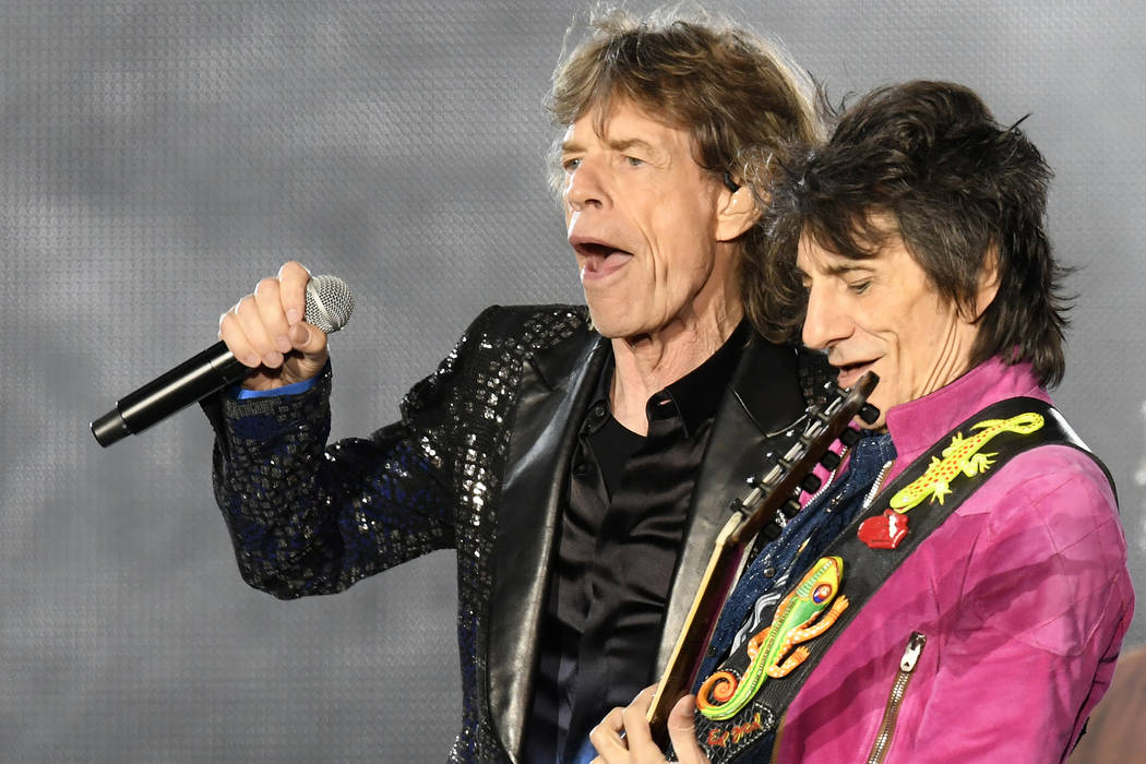 Guitar player Ron'Wood, right, and singer Mick Jagger, of the British band 'The Rolling Stones' perform on stage during a concert of their European tour 'Stones - No Filter' in Zurich, Switzerland ...