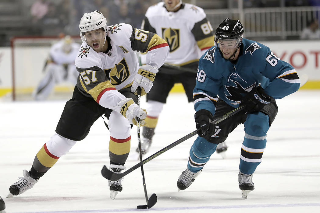 Vegas Golden Knights left wing David Perron (57) battles for the puck against San Jose Sharks right wing Melker Karlsson (68) during the first period of a preseason NHL hockey game, Thursday, Sept ...