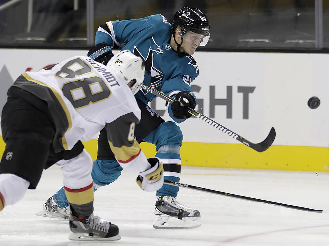 San Jose Sharks right wing Marcus Sorensen shoots past Vegas Golden Knights defenseman Nate Schmidt (88) during the second period of a preseason NHL hockey game, Thursday, Sept. 21, 2017, in San J ...