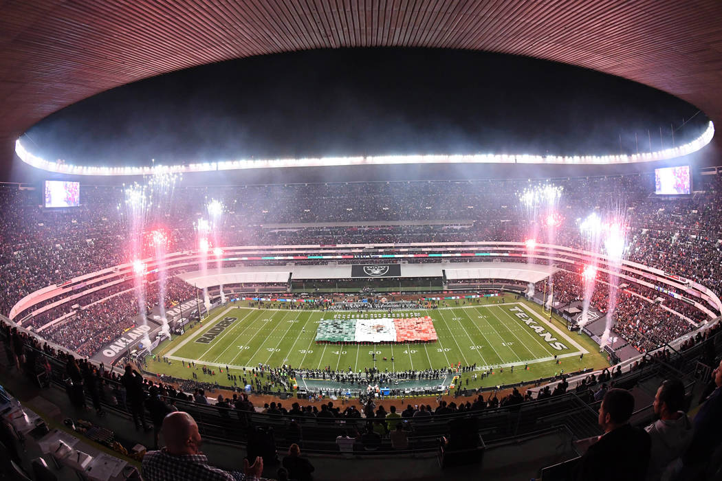 Nov 21, 2016; Mexico City, MEX; General overall view of a Mexican flag on the field and fireworks during the playing of the Mexico national anthem before a NFL International Series game between th ...