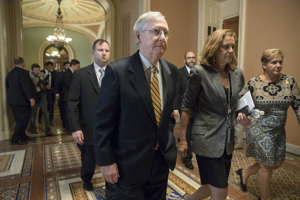 Senate Majority Leader Mitch McConnell, R-Ky., heads to a meeting with Treasury Secretary Steven Mnuchin, Trump's top economic adviser Gary Cohn, and members of the Senate Budget Committee at the  ...