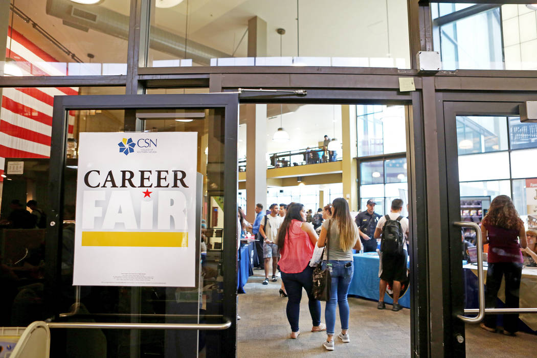 People enter the College of Southern Nevada's Career Fair in North Las Vegas, Wednesday, Sept. 13, 2017. The carrier fair provides a space to connect students and other job seekers with local empl ...