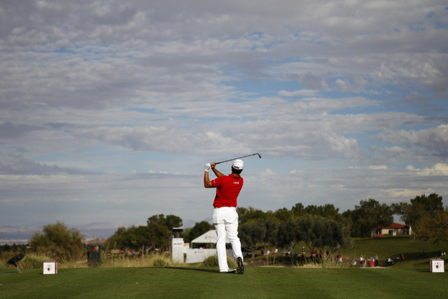 Scott Piercy hits a drive ball from the 17th tee in the third round of the Shriners Hospitals for Children Open golf tournament at TPC Summerlin, 1700 Village Center Circle, in Las Vegas Saturday, ...