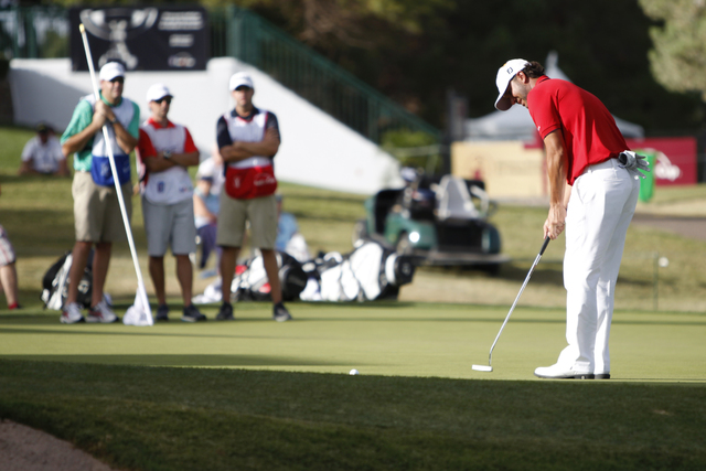 Scott Piercy putts the ball on the 18th green in the third round of the Shriners Hospitals for Children Open golf tournament at TPC Summerlin, 1700 Village Center Circle, in Las Vegas Saturday, Oc ...