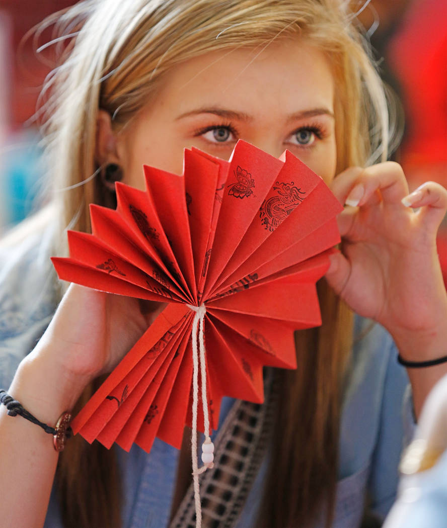 Sienna Jade, 17, of Las Vegas makes a fan during the Asian Heritage Celebration at the Springs Preserve in Las Vegas, Saturday, Sept. 23, 2017. Chitose Suzuki Las Vegas Review-Journal @chitosephoto