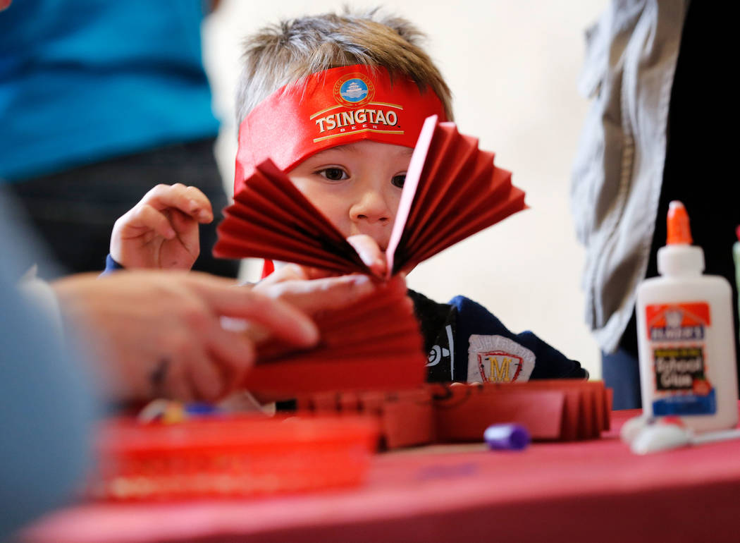 Caleb Hippler, 3, of Las Vegas makes a fan during the Asian Heritage Celebration at the Springs Preserve in Las Vegas, Saturday, Sept. 23, 2017. Chitose Suzuki Las Vegas Review-Journal @chitosephoto