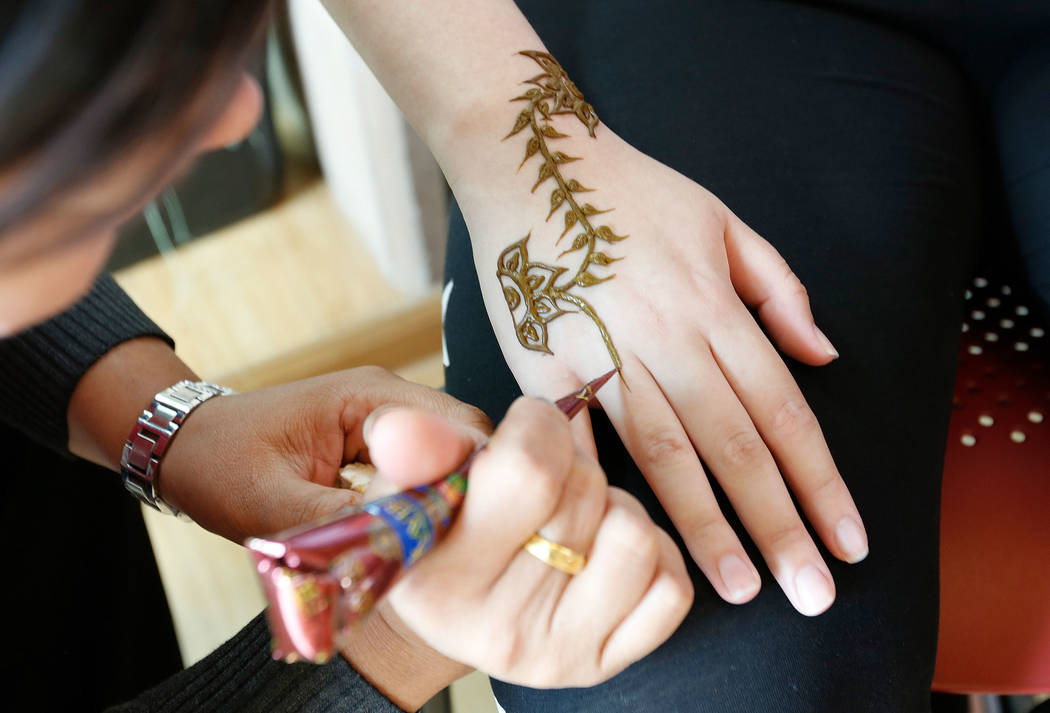 Usha Rana of Patel's Threading & Henna Art, draws the design with henna during the Asian Heritage Celebration at the Springs Preserve in Las Vegas, Saturday, Sept. 23, 2017. Chitose Suzuki Las ...