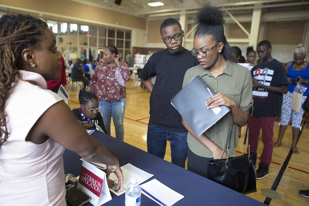 Sunrise Mountain senior Dalayna Bolin, right, asks questions about Spelman College during the 18th annual Historically Black Colleges & Universities Recruitment Fair at  Doolittle Community Ce ...