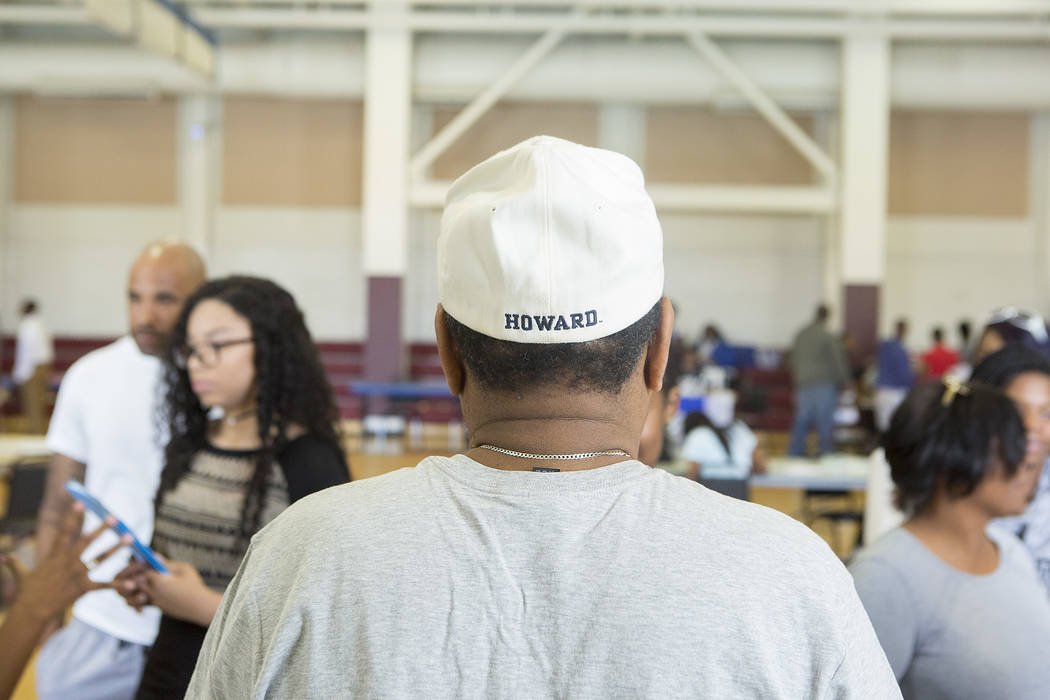 Howard University alumnus Ryan Myers sports a Howard hat while he answers questions about the university during the 18th annual Historically Black Colleges & Universities Recruitment Fair at   ...