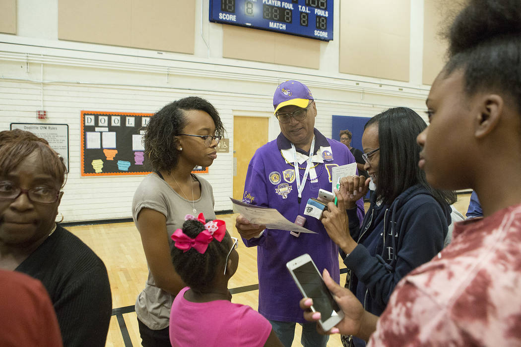 Benedict College western recruiter Richard Pickutt, center, answers questions during the 18th annual Historically Black Colleges & Universities Recruitment Fair at  Doolittle Community Center  ...