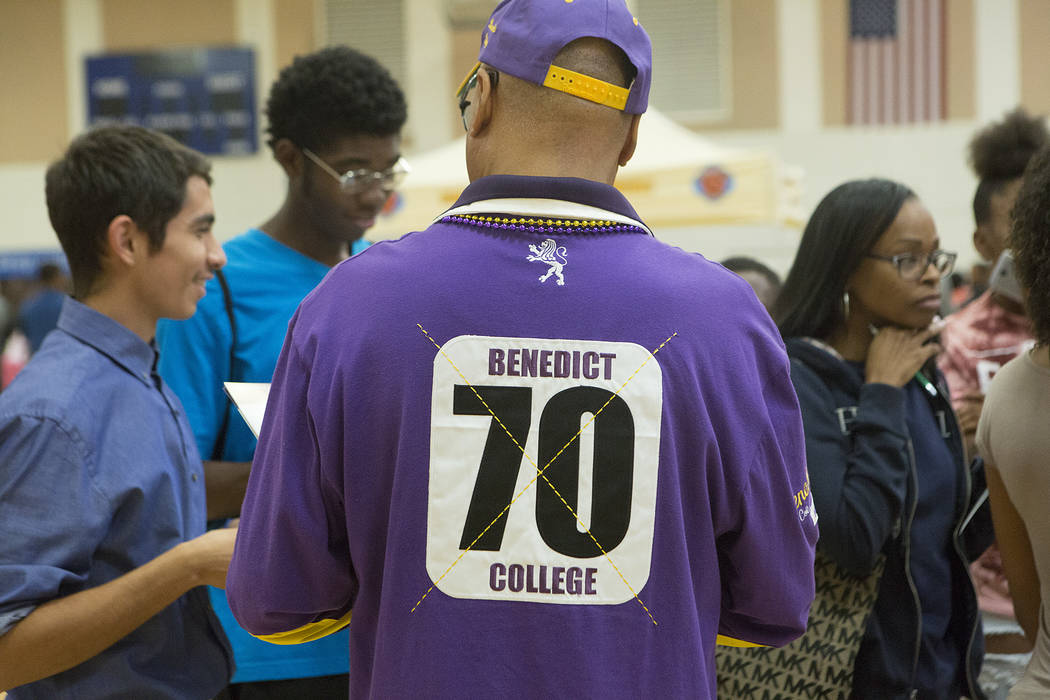 Benedict College western recruiter Richard Pickutt answers questions during the 18th annual Historically Black Colleges & Universities Recruitment Fair at  Doolittle Community Center on Saturd ...