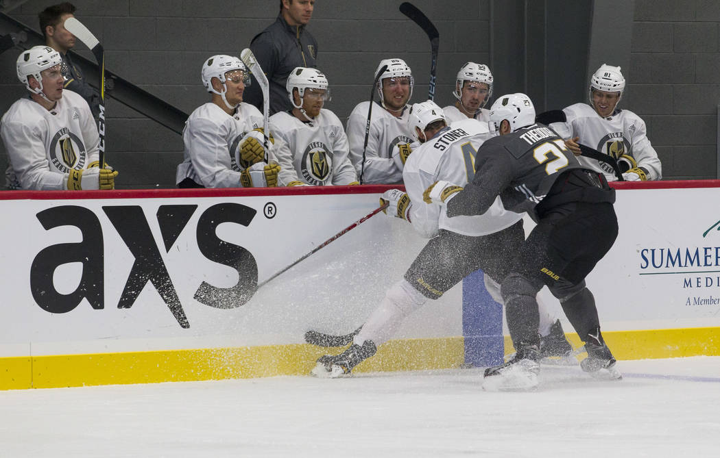 Vegas Golden Knights left defenseman Clayton Stoner (4) and Golden Knights left defenseman Shea Theodore (27) vie for the puck in a scrimmage game during the NHL team's practice at the City Nation ...