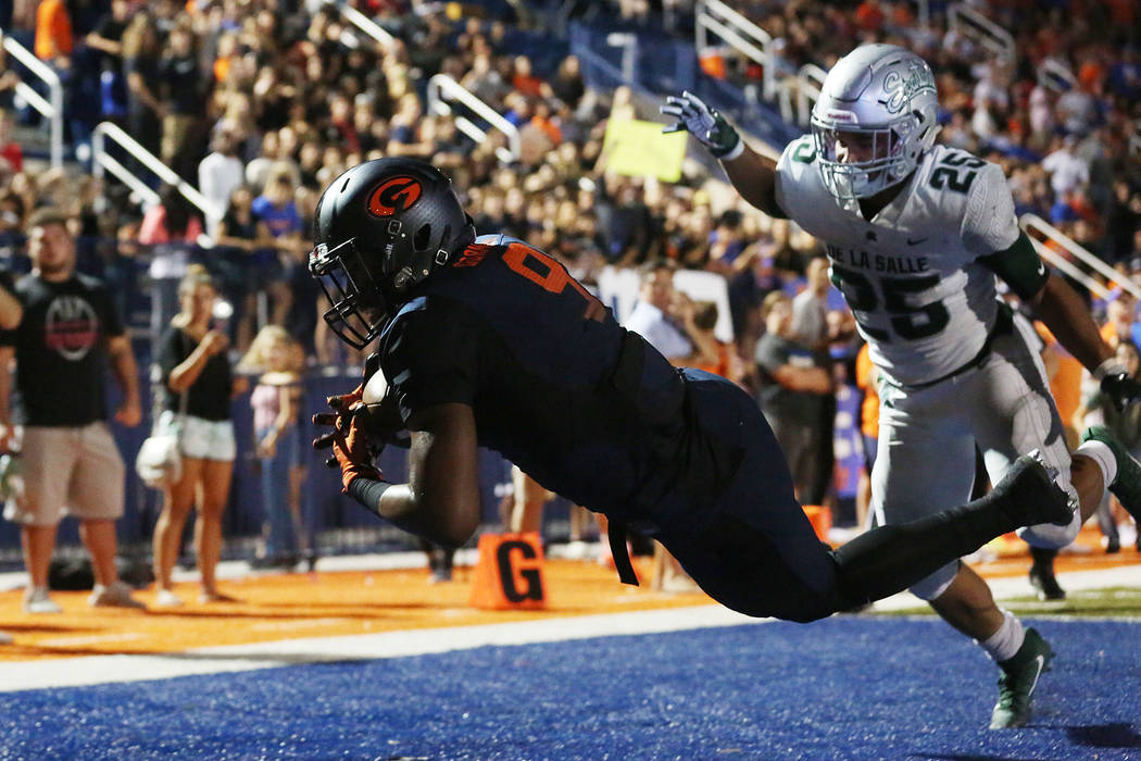 Bishop Gorman's Brevin Jordan (9) dives into the end zone with the ball for a touchdown during the first half of the game at Bishop Gorman High School on Saturday, Sept. 16, 2017, in Las Vegas.  B ...
