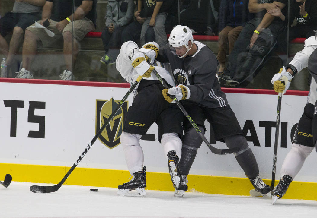 Vegas Golden Knights centerman Jonathan Marchessault, left, (81) and Golden Knights right wing Reilly Smith (19) vie for the puck in a scrimmage game during the NHL team's practice at the City Nat ...