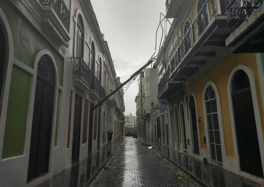 An electric pole lays after it snapped in half during Hurricane Maria in Old San Juan, Puerto Rico, Wednesday, Sept. 20, 2017. The strongest hurricane to hit Puerto Rico in over 80 years tore off  ...