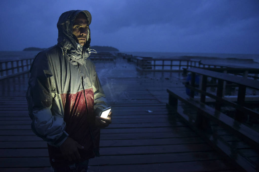 David Cruz Marrero watches the waves at Punta Santiago pier hours before the imminent impact of Maria, a Category 5 hurricane that threatens to hit the eastern region of the island with sustained  ...