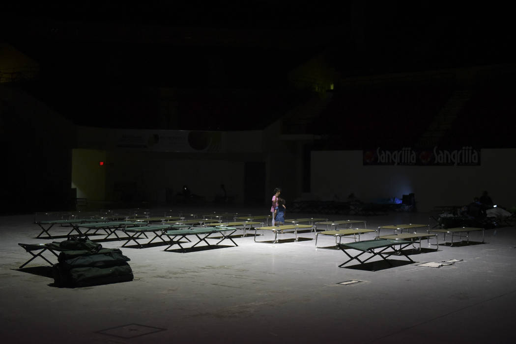 Two girls play on cots at Humacao Arena refugee center while waiting for the imminent impact of Maria, a Category 5 hurricane that threatens to hit the eastern region of the island with sustained  ...