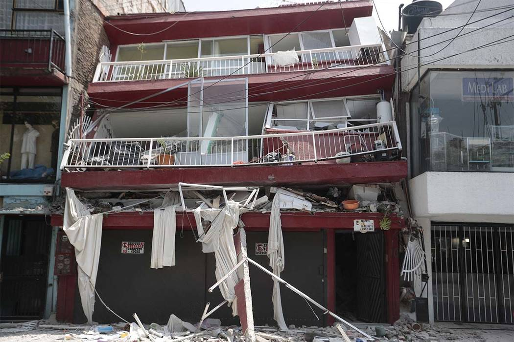 A heavily damaged building stands after an earthquake in the Narvarte neighborhood of Mexico City, Tuesday, Sept. 19, 2017. A magnitude 7.1 earthquake has rocked central Mexico, killing at least 5 ...